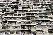 Apartment block housing slums. Yaumatei. Kowloon. Hong Kong. China