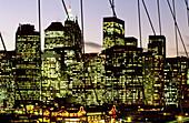 Nighttime view from the Brooklyn Bridge on Lower Manhattan skyline. New York City, USA