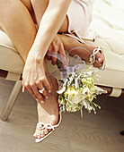 woman holding bouquet by feet