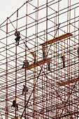 Adult, Adults, Color, Colour, Construction, Daytime, Exterior, Full-body, Full-length, Hazardous, Height, Human, Outdoor, Outdoors, Outside, People, Person, Persons, Risky, Scaffold, Scaffolding, Structure, Structures, Tall, Work, Worker, Workers, Working