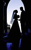 Adult, Adults, Back-light, Backlight, Bond, Bonding, Bonds, Bouquet, Bouquets, Bridal couple, Bride, Bridegroom, Bridegrooms, Brides, Ceremonies, Ceremony, Color, Colour, Contemporary, Couple, Couples, Dress, Dressed up, Dresses, Dusk, Elegance, Elegant,