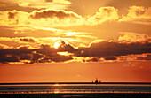 Fishing boat at sunset. North Sea, Germany