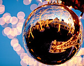 Reflection of a tavern on the Green in a giant Christmas ball. New York city, New York. USA.