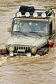 4x4, Adventure, Adventures, Blocked, Central America, Color, Colour, Compete, Competing, Competition, Competitions, Contemporary, Cross, Crossing, Dangerous, Daytime, Exterior, Flood, Flooded, Flooding, Four-wheel drive, Hazard, Jalisco, Latin America, Ma