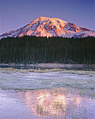 Daybreak on Mount Rainier from Reflection Lake. Mount Rainier National Park. Washington. USA.