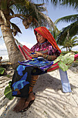 Kuna indian Woman to sew a Mola (traditional dress). San Blas Islands, Panama.