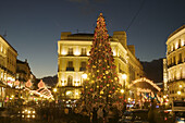 Activity, Architecture, Building, Buildings, Celebrate, Celebrating, Celebration, Celebrations, Christmas, Christmas tree, Christmas trees, Cities, City, Cityscape, Cityscapes, Color, Colour, Decoration, Europe, Exterior, Lights, Madrid, Night, Nighttime,