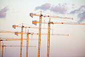 Color, Colour, Construction, Construction site, Construction sites, Crane, Cranes, Daytime, Engineering, Exterior, Height, Industrial, Industry, Outdoor, Outdoors, Outside, Skies, Sky, Tall, Urban, Work, Working, M37-628752, agefotostock