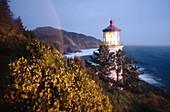 Rainbow over Heceta Head lighthouse. Oregon coast. USA.