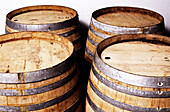 Four large wooden barrels from vineyard used for storing and aging wine