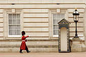 Guard marches back and forth from his station at Buckingham Palace, London.