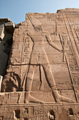 Carving of Egyptian priest in wall at Karnak. Luxor, Egypt.