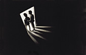 30s 40s man and male adolescent silhouetted in doorway. Bright light in room they are entering; darkness in room they are leaving.