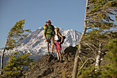 A couple take a break while hiking near Mount Adams. Washington. USA