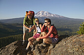 Three friends take a break while hiking near Mount Adams. Washington. USA