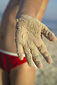 Beach, Beaches, Child, Childhood, Children, Close up, Close-up, Closeup, Color, Colour, Concept, Concepts, Contemporary, Covered, Daytime, Detail, Details, Exterior, Hand, Hands, Holiday, Holidays, Human, Infantile, Kid, Kids, Leisure, One, One person, Ou