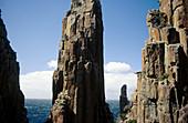 Spectacular sea stacks at Cape Hauy, including the famous Candlestick (centre), Tasman National Park, Tasman Peninsula, Tasmania, Australia
