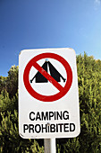No camping sign on summer day