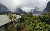 View of cloudy Milford Sound from Milford Lodge, Fiordland National Park, New Zealand.