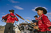 Adult, Adults, Color, Colour, Daytime, Drums, Exterior, Folk, Folklore, Horizontal, Human, Latino, Latinos, Male, Man, Men, Music, Music band, Music bands, Musician, Musicians, Outdoor, Outdoors, Outside, People, Percussion, Person, Persons, Playing, Thre