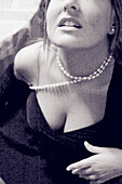 Adult, Adults, B&W, Black-and-White, Caucasian, Caucasians, Chest, Cleavage, Contemporary, Detail, Details, Female, Human, Indoor, Indoors, Inside, Interior, Monochromatic, Monochrome, Necklace, Necklaces, One, One person, People, Person, Persons, Posture