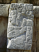 Ancient Mayan stone relief showing profile of a person, panel on the Casa C façade. Palenque. Chiapas, Mexico