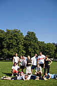 Angel, young woman with wings in a team photo, football in the park, Munich, Bavaria, Germany