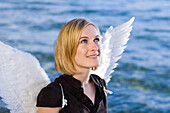 Angel, young woman with wings at Lake Starnberg, Bavaria, Germany