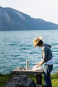 Mid adult man at lake Walchensee, Bavaria, Germany