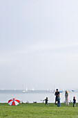 Family playing croquet on the shore of lake Ammersee, Upper Bavaria, Bavaria, Germany