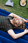 Mid adult man lying on airbed