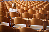 Student sitting in an empty lecture hall, University, Education