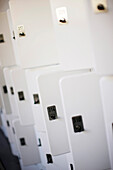 Close up of white lockers, some open