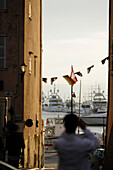 View towards the yacht harbour from a side street, Promenade, St.Tropez, Cote d´Azur, Provence, France