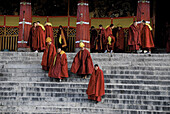 Gelukpa school. Lama going out from a ceremony. Drepung monastery. Lhasa. Tibet