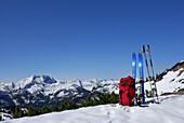 Backpack and skies on summit in snow, Bavarian foothills, Upper Bavaria, Bavaria, Germany