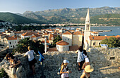 Tourists visit the castle of Budva, Budva, Montenegro