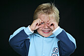 Young boy with fingers round eye, Child, Childhood, Family, Upbringing