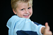 Young boy showing thumbs up, Child, Childhood, Family, Upbringing
