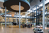 The transparent factory, automobile production plant owned by Volkswagen, modern factory designed to make the production line visible to the outside world. The luxury Phaeton automobile is built here. View into the Kundenforum, Dresden, Saxony, Germany, E