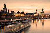 View along river Elber with Bruhl's Terrace, Academy of Fine Arts, Dresden Castle, Standehaus and Hofkirche at night, Dresden, Saxony, Germany