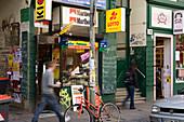 Kiosk with graffiti and advertisement in Susannenstrasse in Schanzenviertel, Hanseatic city of Hamburg, Germany, Europe