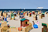 Vacationers relaxing in beach chairs at beach, Travemunde, Lubeck, Schleswig-Holstein, Germany