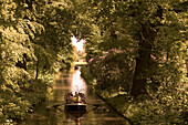 Visitors in a gondola, Dessau-Worlitz Garden Realm, Saxony Anhalt, Germany
