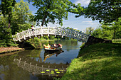 Visitors in a gondola passing White Bridge, Dessau-Worlitz Garden Realm, Saxony Anhalt, Germany