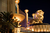 Light reflecting off the basins, statues and fountains which decorate the grand facade of the MGM Grand Hotel and Casino, Las Vegas, Nevada, USA
