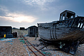 Abandoned fishing boats on the beach, Dungeness, Kent, England, Europe