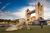 Modern swimming sculpture along the banks of the Themse, Swimmer, Tower Bridge in the background, City of London, London, England, Europe