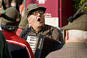 Adunata Nazionale (yearly reunion of former soldiers) of Alpini (a highly decorated elite infantry corps of the Italian Army): old Alpino singing and playing accordion during the military parade