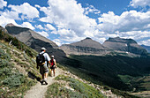Hikers at Piegan Pass. Mt. Glacier National Park. USA.